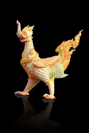 Thai style a molded figure of swan that an animals in fairy tale,on black background Stock Photo - 27500210