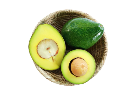 The basket of fresh avocado fruits on white background.