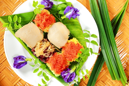 Thai dessert, Sticky Rice with various Topping on banana leaf.