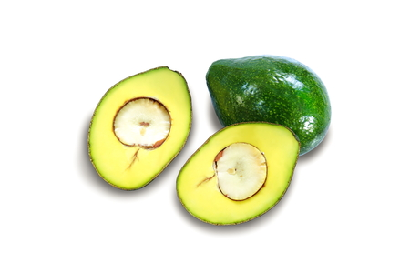 Fresh avocado fruits sliced ��in half on white background.