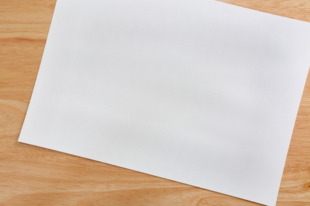 White paper texture background on wood.