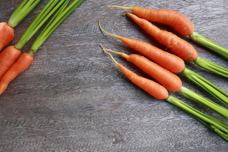 close up group of fresh carrot on wooden table.