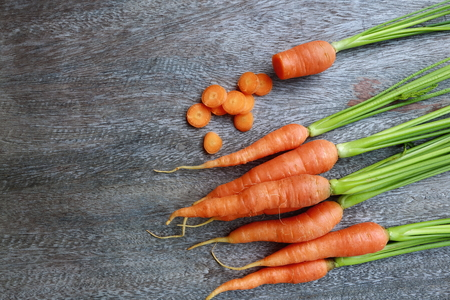 group of fresh carrot on wooden table. Standard-Bild