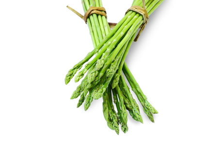 Bundle of asparagus on white background.
