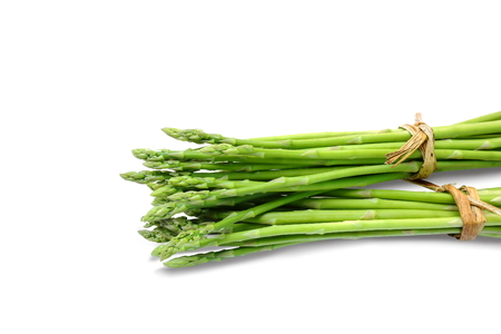 Bundle of asparagus on white background. Clipping paths.