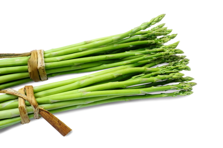 Bundle of fresh asparagus on white background. Standard-Bild
