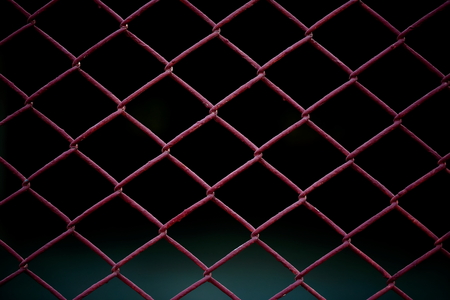Metal Mesh Fence isolated on black background.