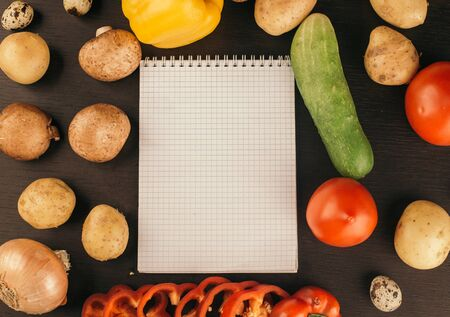 Shopping list, recipe book, diet plan. Fresh raw vegetables, fruit and ingredients for cooking. top view, place for text.