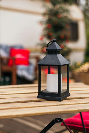 Christmas decorations. Street lamp with candle on the table. outdoor. Decoration Xmas and holiday