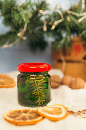 Jar with honey tincture of forest pine needles. Means and medicines of folk medicine.