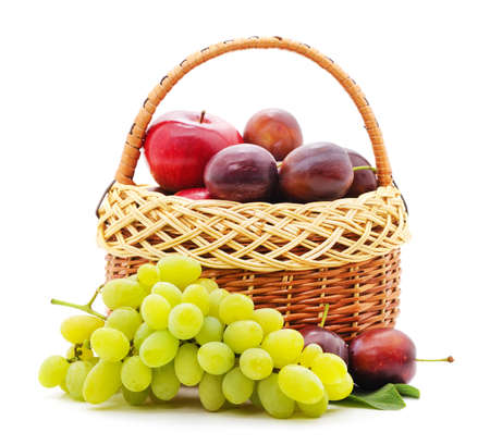 Fruits in a basket isolated on a white background.