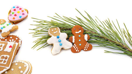 Christmas gingerbread cookies with a pine branch isolated on a white background.