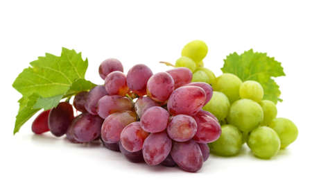 Green grapes with leaves isolated on a white background.
