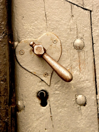 door lock love: Old heart-shaped lock and keyhole close-up