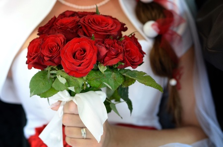 Bride, who holds a bouquet of roses Stock Photo