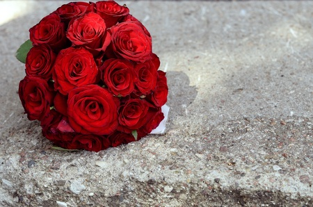 Bouquet of red roses on the ground