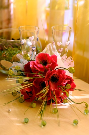 arrangement of two glasses and bridal bouquet Stock Photo