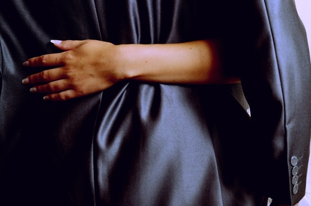 Womans hand embraces the back of man