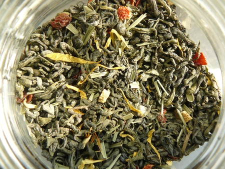 Dried green tea in the glass pot