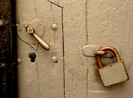 door lock love: Old heart shaped lock and keyhole close-up