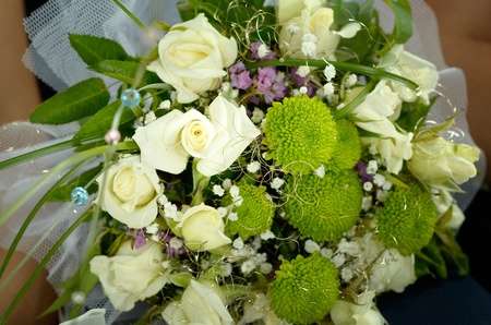 Wedding bouquet of white roses and green leaves