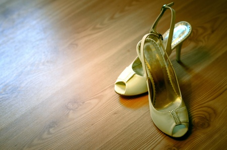 Womens high heels on the wood floor Stock Photo