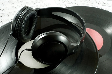 The black headphones, musical records and notes Stock Photo