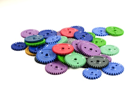 Heap colored gears isolated on a white background Stock Photo