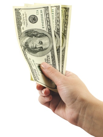 Hand holds three hundred dollars isolated on a white background