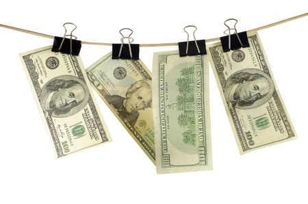 Clothesline cord with dollars isolated on a white background Stock Photo