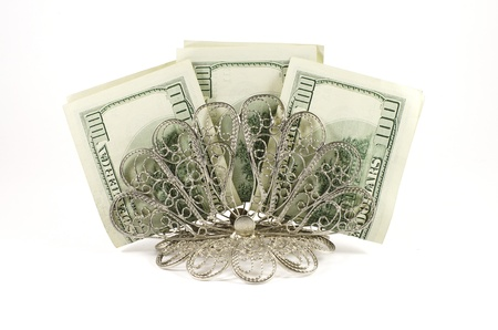 Napkin holder with three hundred dollars isolated on a white background