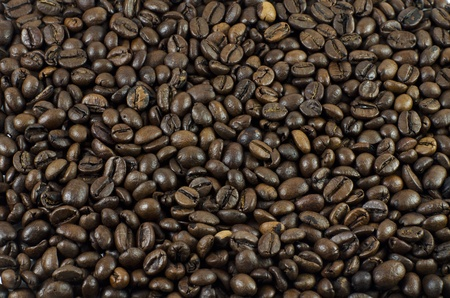 Background of roasted and peeled grains of black coffee Stock Photo