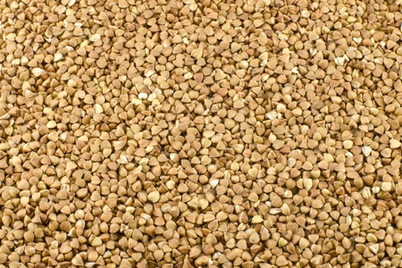 Background of the raw selective buckwheat seeds Stock Photo