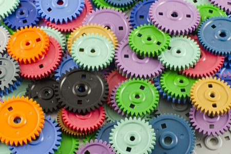 Background of the plastic different colored gears photo