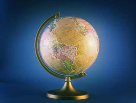 little antique globe isolated on blue background
