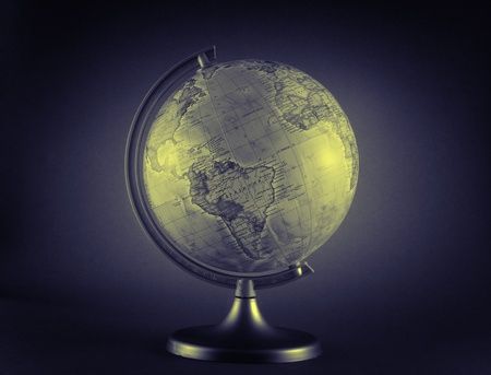 little antique globe isolated on sepia color Stock Photo
