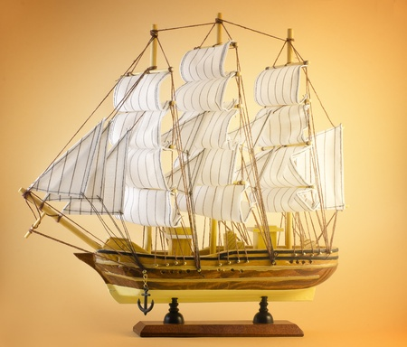 sailing ship toy isolated on yellow background