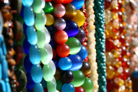 amber coloured: A lot of colored beautiful beads at the bazaar Stock Photo
