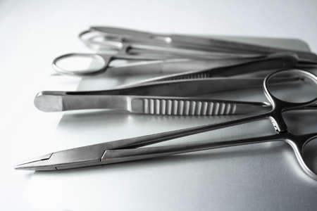 Surgical instruments on metal tray. Scalpel, clamp, scissors, surgical forceps on white background. Medical instruments Archivio Fotografico