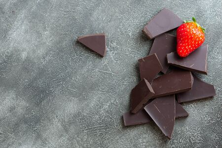 Chocolate with strawberry isolated on grey background. Copy space.
