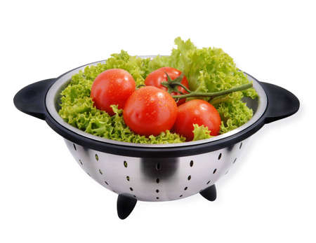 Red Tomato with lettuce isolated on white photo