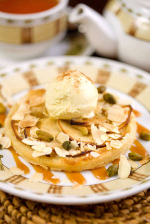 Dessert with ice-cream, nuts and tea photo