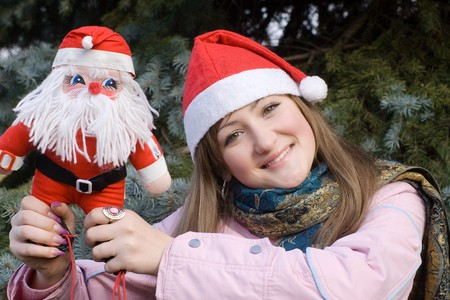girl smiling holding Santa doll Stock Photo - 3944579