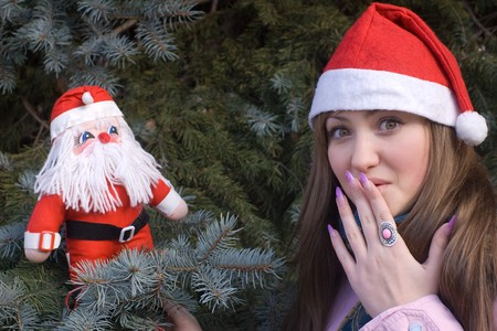 surprised girl with Santa doll Stock Photo - 3944550