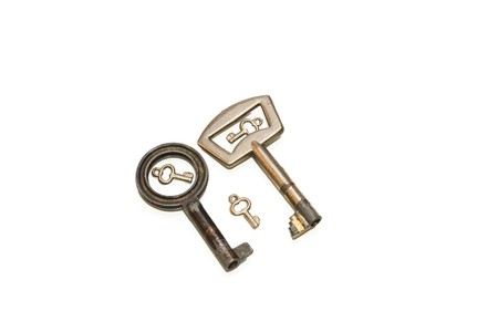Family of two big and three small keys isolated on white photo