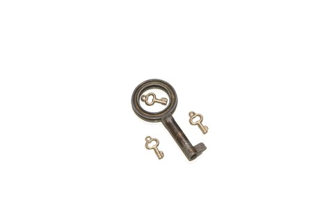 Big key with a small one inside and two on sides isolated on white Stock Photo - 4296288