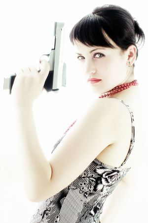 Pretty young woman with red lips and gun photo