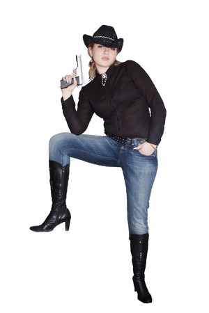 Western girl in black with a gun standing isolated on white