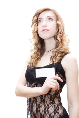 Blonde in black lingerie holding blank card isolated on white Stock Photo - 4501320