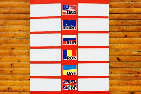 hryvna: Currency exchange board on wooden background with blank spaces Stock Photo